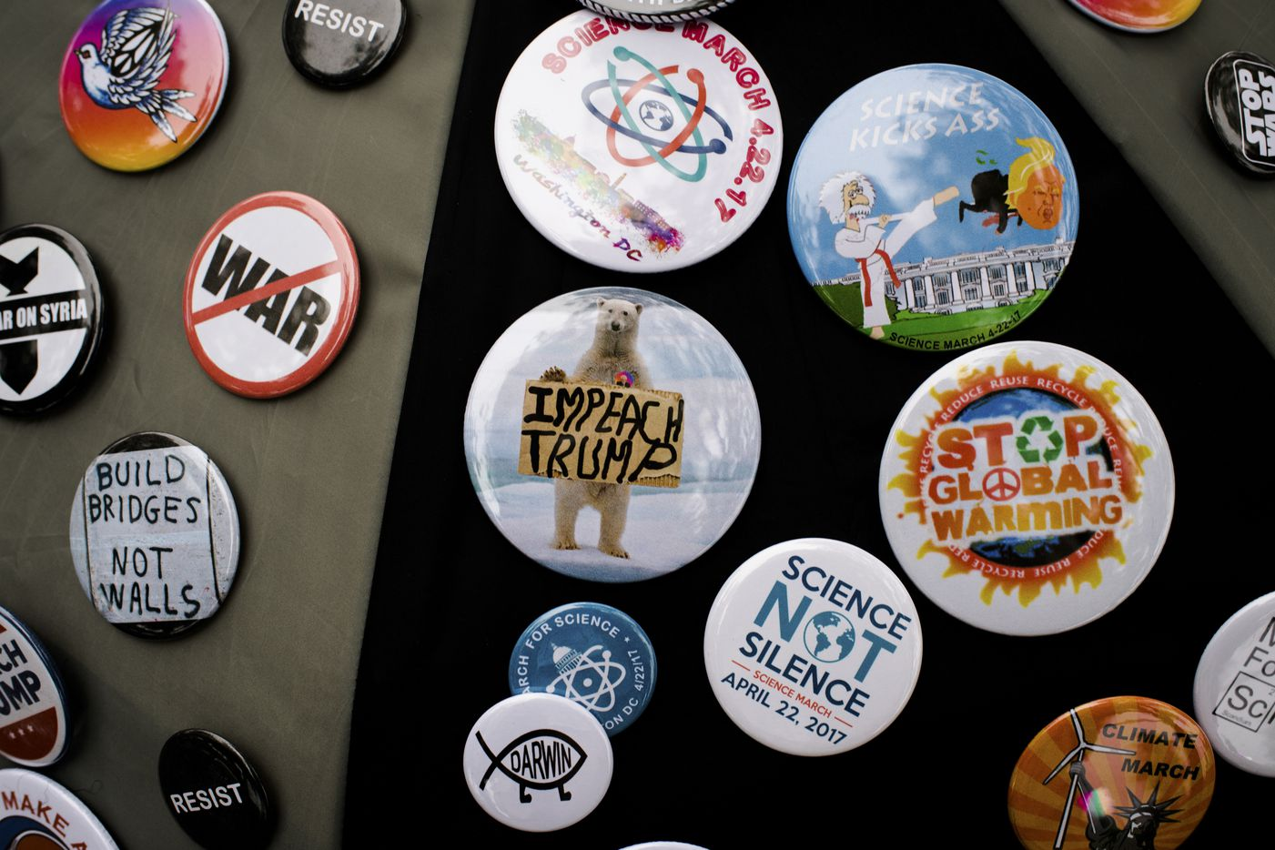 Buttons for sale outside of the Washington Monument before the March for Science in Washington, April 22, 2017. Thousands of scientists and science advocates demonstrated in Washington and in smaller events around the world to support, defend and celebrate the scientific enterprise. (Hilary Swift/The New York Times)