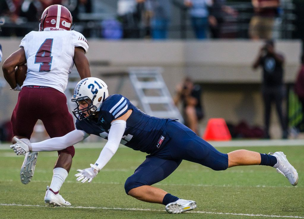 Mesquite running back LaDarius Turner (4) gets past L.D. Bell defensive back Kyle Kamerer (21) on a 59-yard touchdown run during the first half of a high school football game on Thursday, Sept. 19, 2019, in Bedford, Texas. (Smiley N. Pool/The Dallas Morning News)