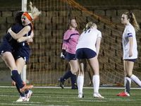 Wakeland midfielder Allie Perry (15) embraces midfielder McKenna Jenkins (22) after Jenkins made the winning goal in the second overtime as Wakeland High School played Highland Park High School in the Class 5A Region II semifinal girls soccer match at Memorial Stadium in Mesquite on Friday, April 9, 2021.