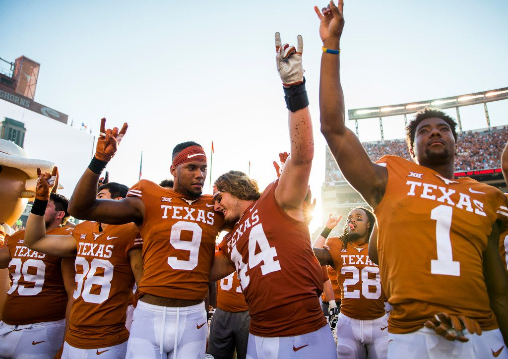 Texas Longhorns celebrate a 23-17 win over the Baylor Bears on Saturday, October 13, 2018 at Darrell K Royal Memorial Stadium in Austin, Texas.  (Ashley Landis/The Dallas Morning News)