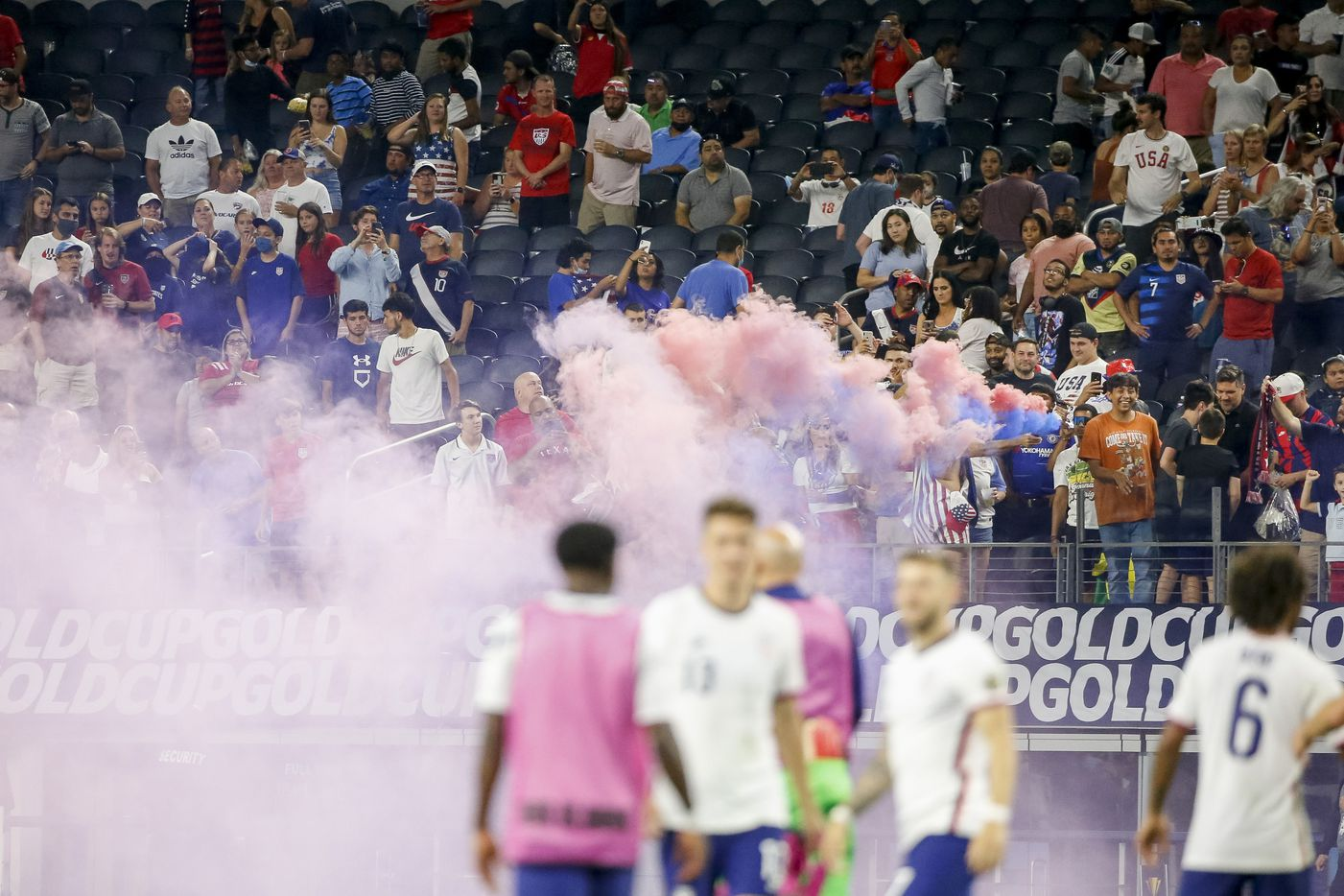 A smoke bomb fills the air after a CONCACAF Gold Cup quarterfinal soccer match between USA and Jamaica at AT&T Stadium on Sunday, July 25, 2021, in Arlington. (Elias Valverde II/The Dallas Morning News)