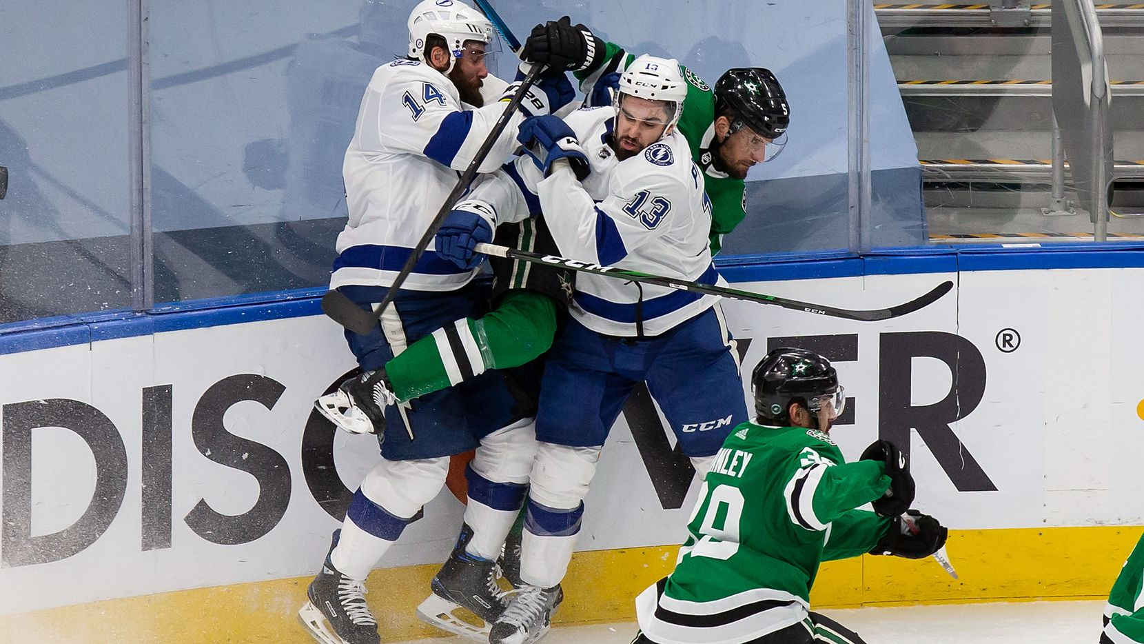 Andrej Sekera (5) of the Dallas Stars is sandwiched by Pat Maroon (14) and Cedric Paquette (13) of the Tampa Bay Lightning during Game Three of the Stanley Cup Final at Rogers Place in Edmonton, Alberta, Canada on Wednesday, September 23, 2020. (Codie McLachlan/Special Contributor)