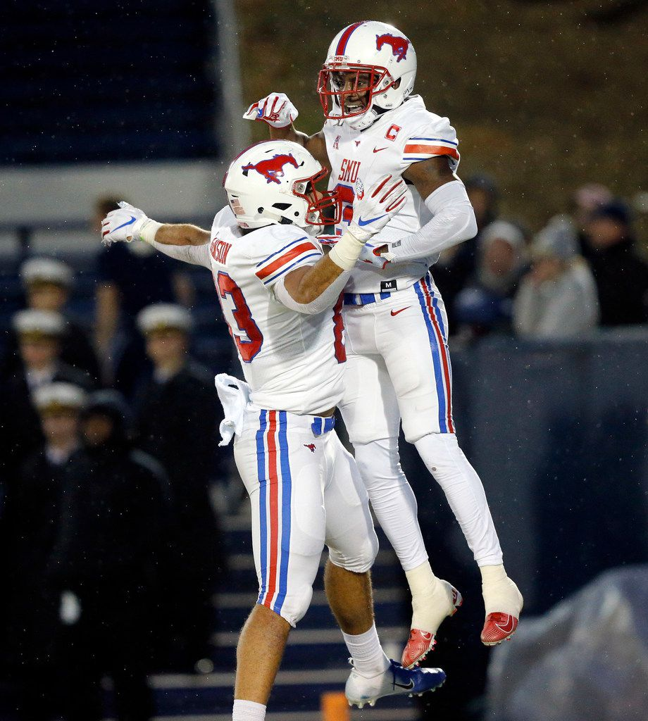 Southern Methodist Mustangs wide receiver James Proche (3) celebrates his second quarter touchdown against the Navy Midshipmen with teammate Kylen Granson (83) at Navy-Marine Corps Memorial Stadium in Annapolis, Maryland, Saturday, November 23, 2019. (Tom Fox/The Dallas Morning News)