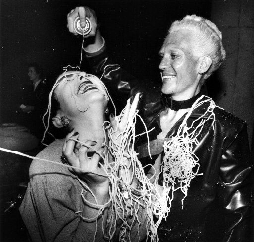 Claudine King gets sprayed by fellow Starck Club staffer Howard Smith on the night of its final party on July 11, 1989 at the end of its first five-year run.
