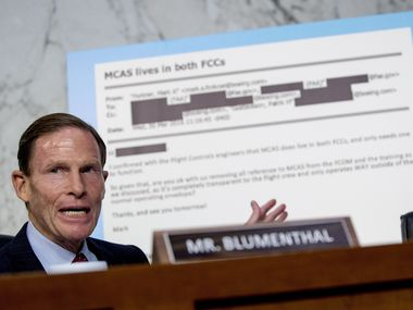 Rep. Richard Blumenthal, D-Conn., displays an email exchange between former Boeing test pilot Mark Forkner and test pilot Patrik Gustavsson  he questions Boeing Company President and Chief Executive Officer Dennis Muilenburg before a Senate Committee on Commerce, Science, and Transportation hearing on 'Aviation Safety and the Future of Boeing's 737 MAX' on Capitol Hill in Washington, Tuesday, Oct. 29, 2019. (AP Photo/Andrew Harnik)