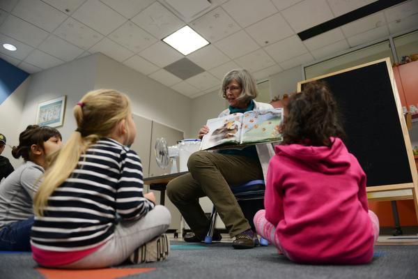 Coppell Librarian Betsy Merrill reads to children during family story time in this file photo. With many aspects of education moving online due to the pandemic, DeSoto ISD librarians have created a virtual holiday reading room to bring holiday stories to students.