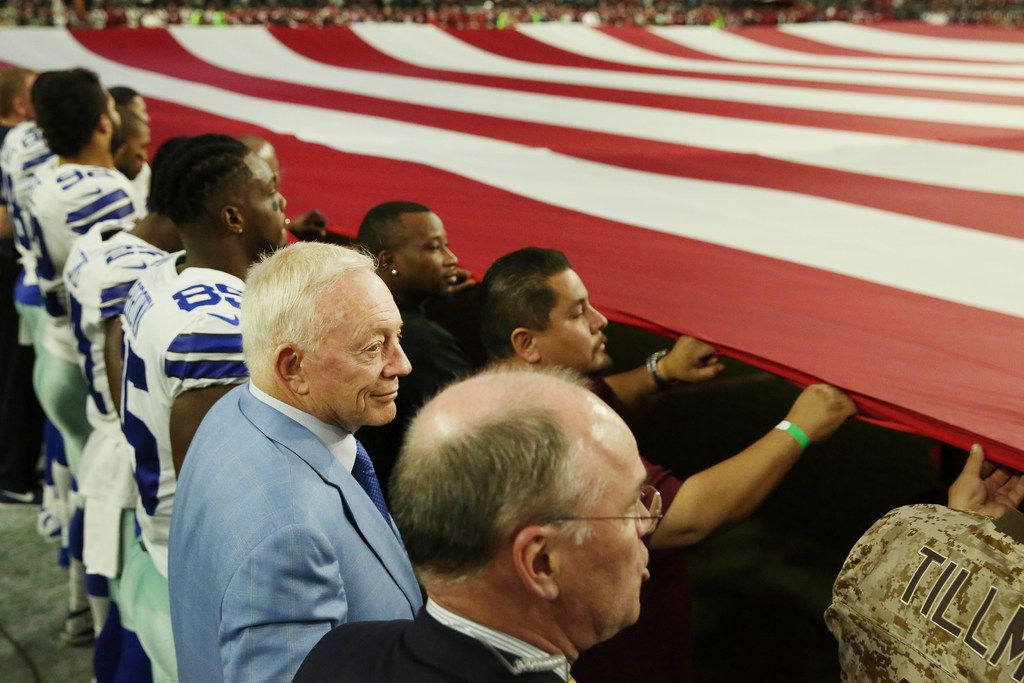Dallas Cowboys owner Jerry Jones stand locked in arms with his team and personnel during the playing of the United States National Anthem before a National Football League game between the Dallas Cowboys and the Arizona Cardinals at University of Phoenix Stadium in Glendale, Arizona on Monday September 25, 2017. The team kneeled for a moment prior to the anthem. (Andy Jacobsohn/The Dallas Morning News)