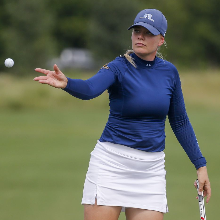 Professional golfer Matilda Castren tosses a ball to her caddie on the No. 18 green during the second round of the LPGA VOA Classic on Friday, July 2, 2021, in The Colony, Texas. (Elias Valverde II/The Dallas Morning News)