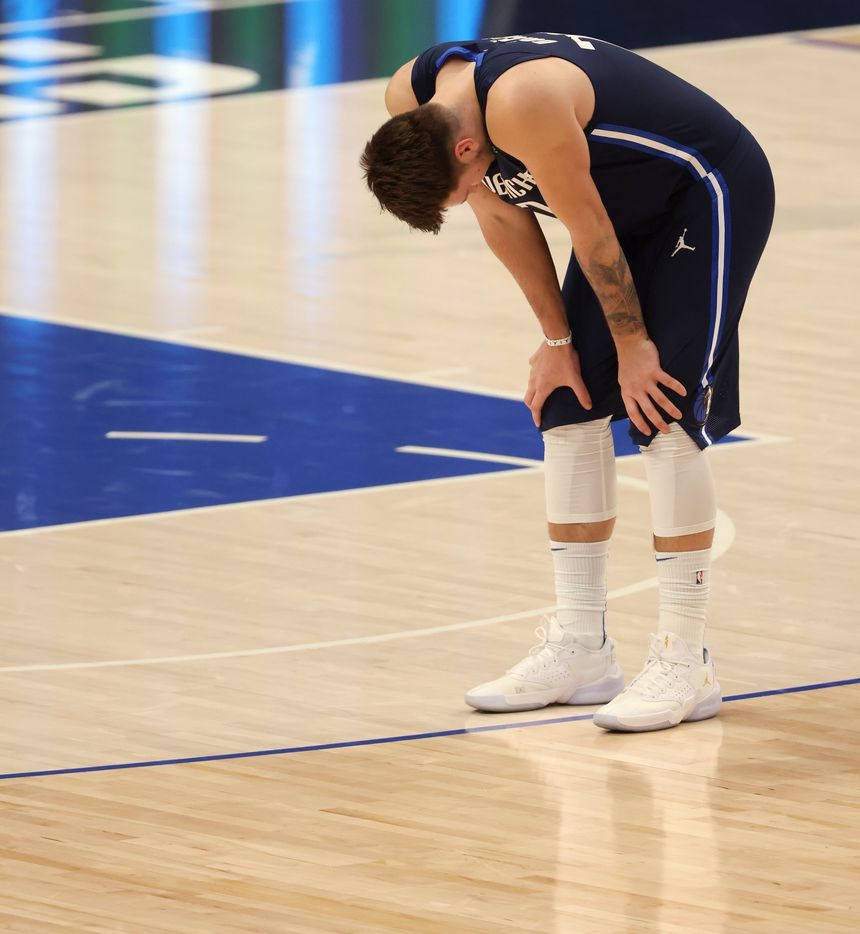 Dallas Mavericks guard Luka Doncic (77) gathers himself during a break in play in a game against the Phoenix Suns during the second quarter of play at American Airlines Center on Monday, February 1, 2021in Dallas. (Vernon Bryant/The Dallas Morning News)
