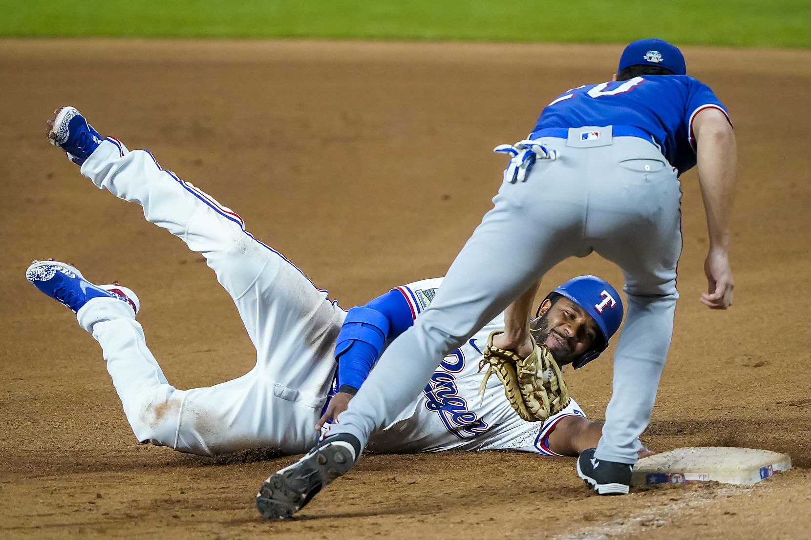 Shortstop Elvis Andrus is picked off first base as first baseman infielder Greg Bird applies the tag during Texas Rangers Summer Camp at Globe Life Field on Thursday, July 16, 2020.