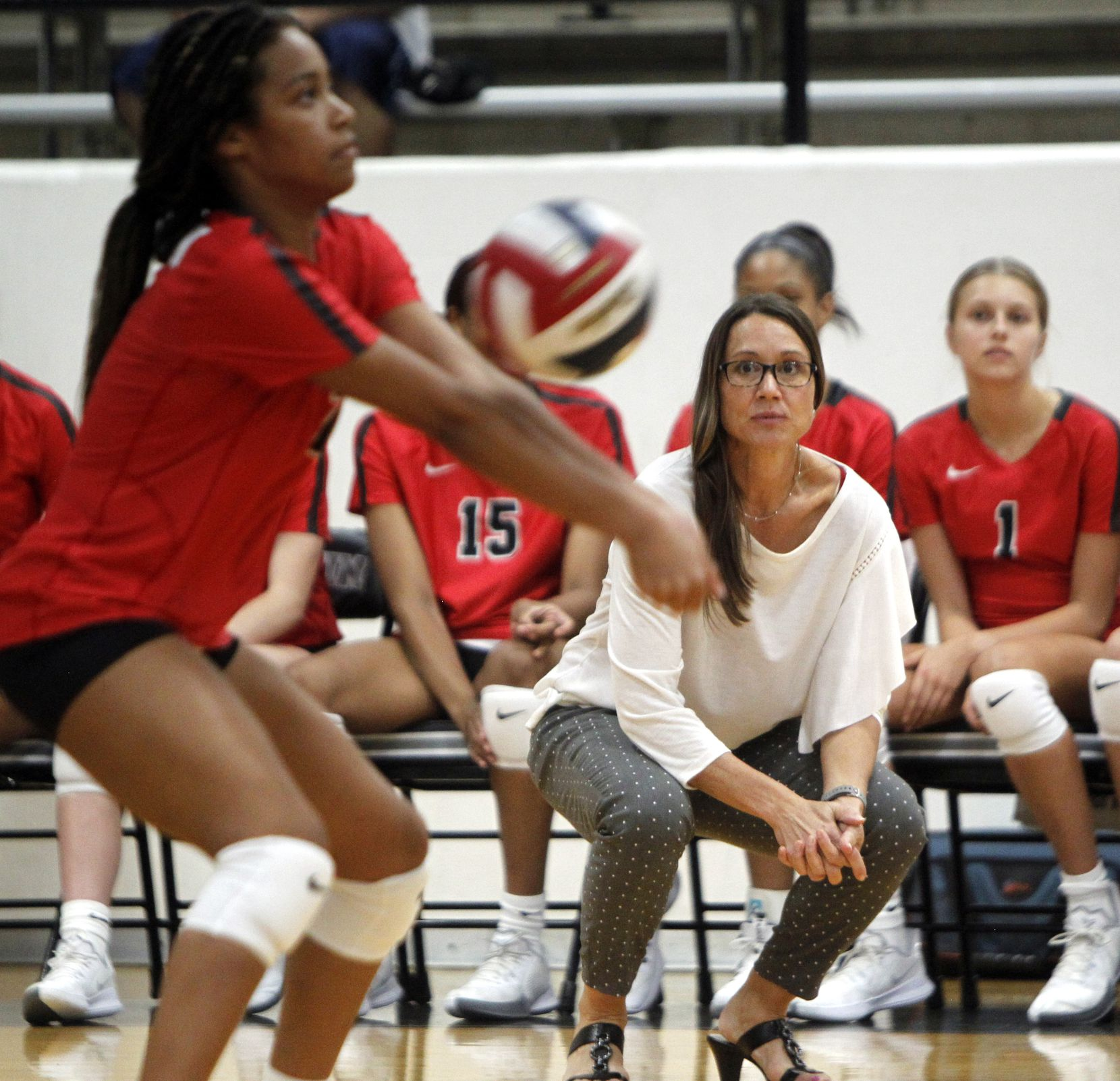 Arlington Martin head coach Rhonda Dunn looks on from the team bench as Aubrey Wright (2) sets the ball during the opening set against South Grand Prairie. Martin won the match in straight sets. The two teams played their volleyball match at Arlington Martin High School in Arlington on September 14, 2021. (Steve Hamm/ Special Contributor)