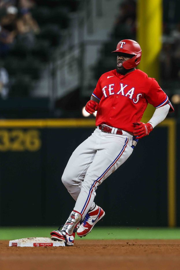 Texas Rangers Adolis Garcia (53) reaches second base against Seattle Mariners during fourth inning at Globe Life Field in Arlington, Texas, Friday, July 30, 2021. (Lola Gomez/The Dallas Morning News)