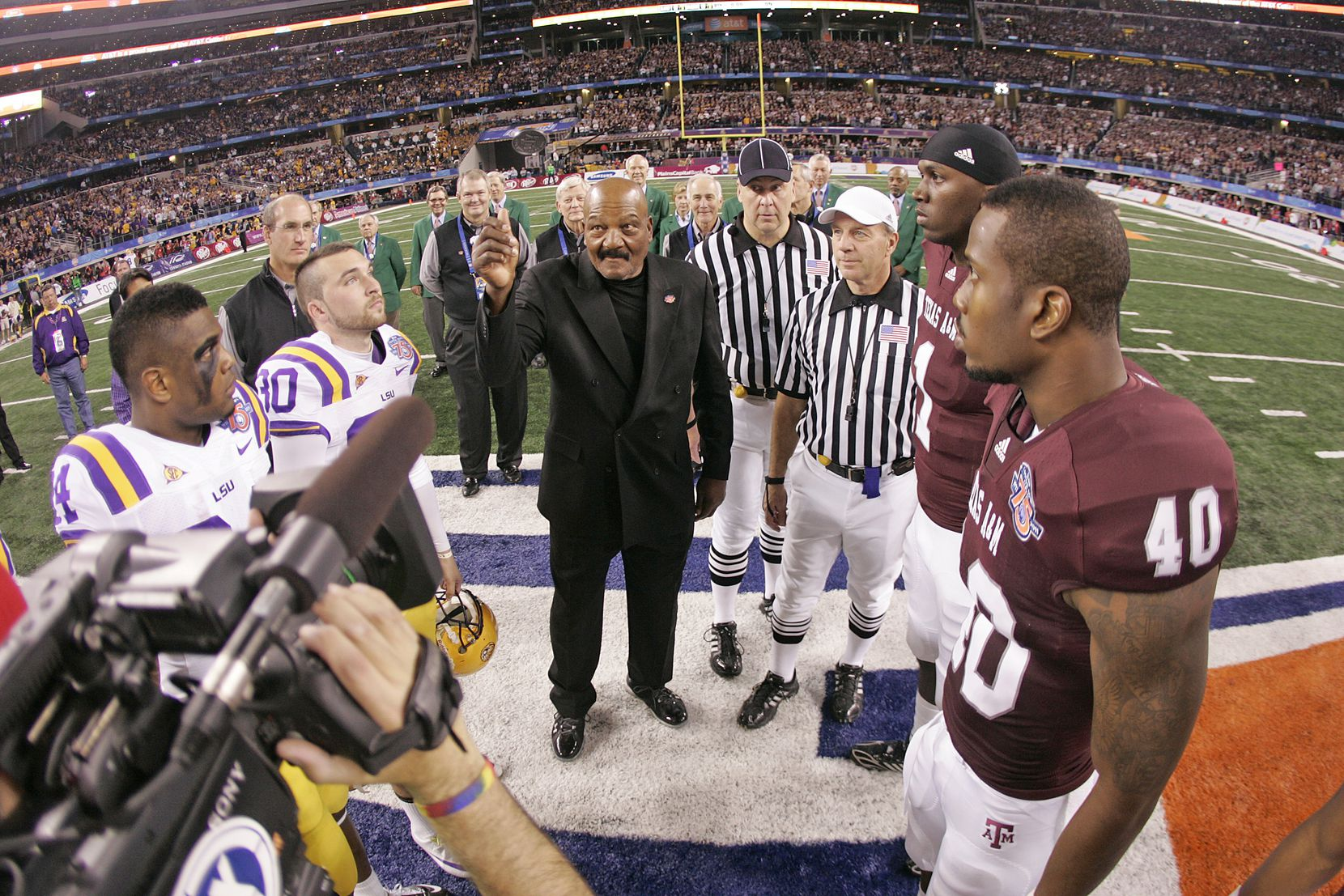 Jim Brown flipped the coin at the 75th anniversary of the Cotton Bowl Classic between LSU and Texas A&M in 2011. Brown represented 75 years of student-athletes that have competed in the Classic.