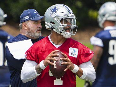 Dallas Cowboys head coach Mike McCarthy watches quarterback Dak Prescott (4) run a drill during a minicamp practice at The Star on Tuesday, June 8, 2021, in Frisco.