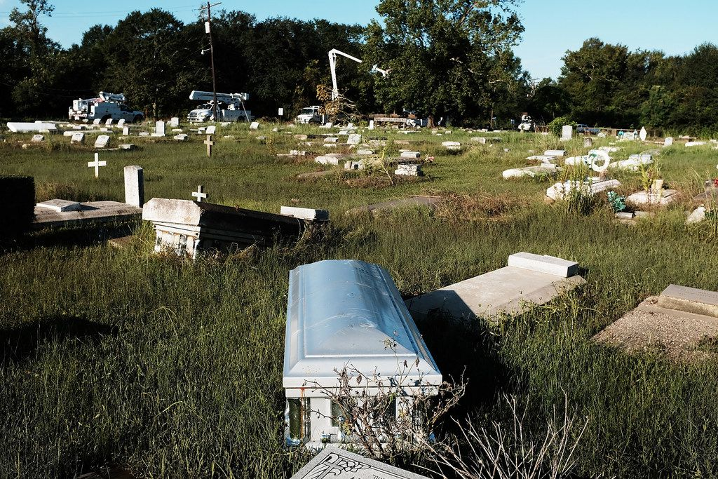 A casket, uprooted by the floods, sits in a cemetery in Orange as Texas slowly moves toward recovery from the devastation of Hurricane Harvey on September 7, 2017.