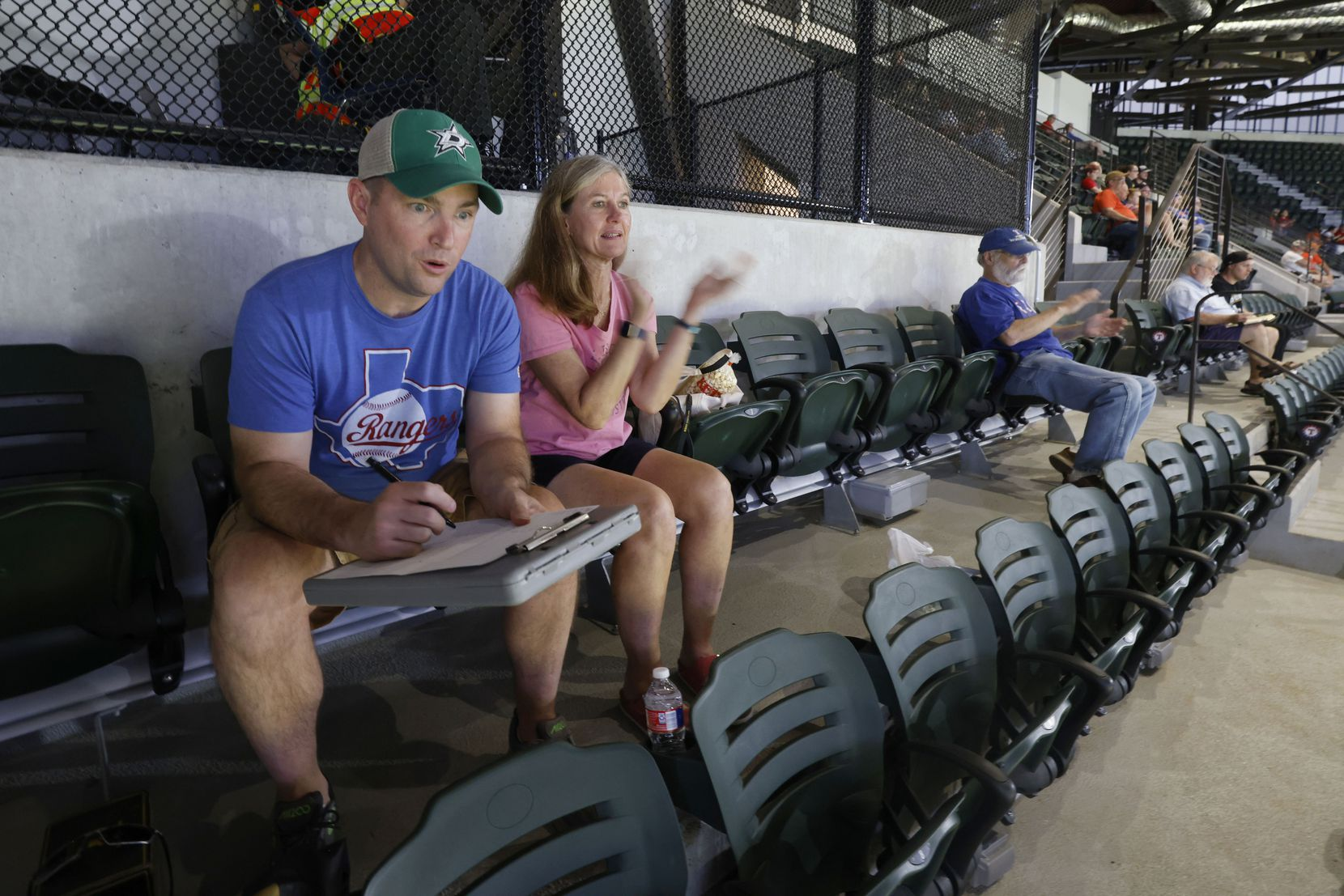 Season ticket holders Dallas Brewton, of Albuquerque, NM and  Pam Lunk of Arlington, watch the Texas Rangers play during an MLB baseball game between the Texas Rangers and the Houston Astros in Arlington, Texas on Thursday, Sept. 16, 2021. (Michael Ainsworth/Special Contributor)