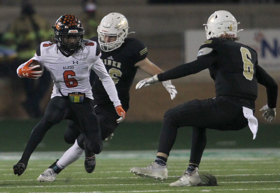 Aledo running back Demarco Roberts (6) makes a jump-cut during a first quarter rush as Wichita Falls Rider defenders Harley Nottingham (16) and Ranse Radtke (6) give chase. The two teams played their Class 5A Division ll state semifinal football playoff game at Apogee Stadium in Denton on January 8, 2021. (Steve Hamm/ Special Contributor)