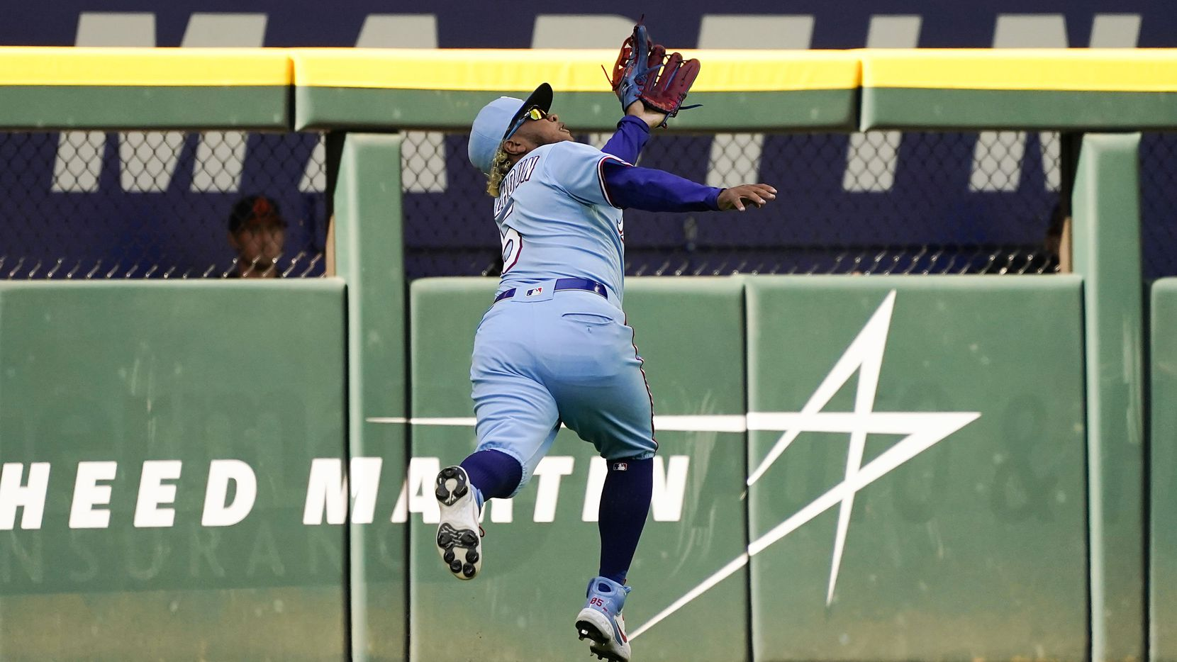 Texas Rangers left fielder Willie Calhoun makes a running catch on a line drive by Baltimore Orioles first baseman Ryan Mountcastle during the tenth inning of a 1-0 walkoff victory at Globe Life Field on Sunday, April 18, 2021.