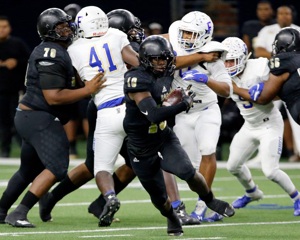 South Oak Cliff Mikeviun Titus (10) breaks loose for a first down during the first half of the team's high school football playoff game against Frisco high at the Star on Friday, November 22, 2019. (John F. Rhodes / Special Contributor)