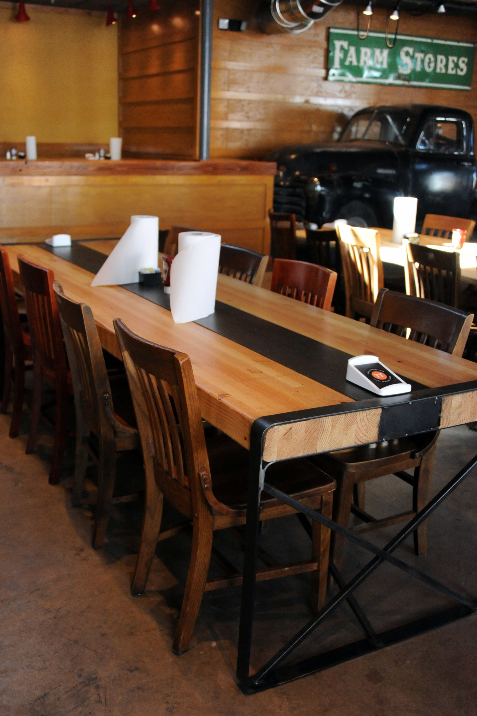 The tables are made from recycled materials at the new Ten 50 BBQ in Richardson.