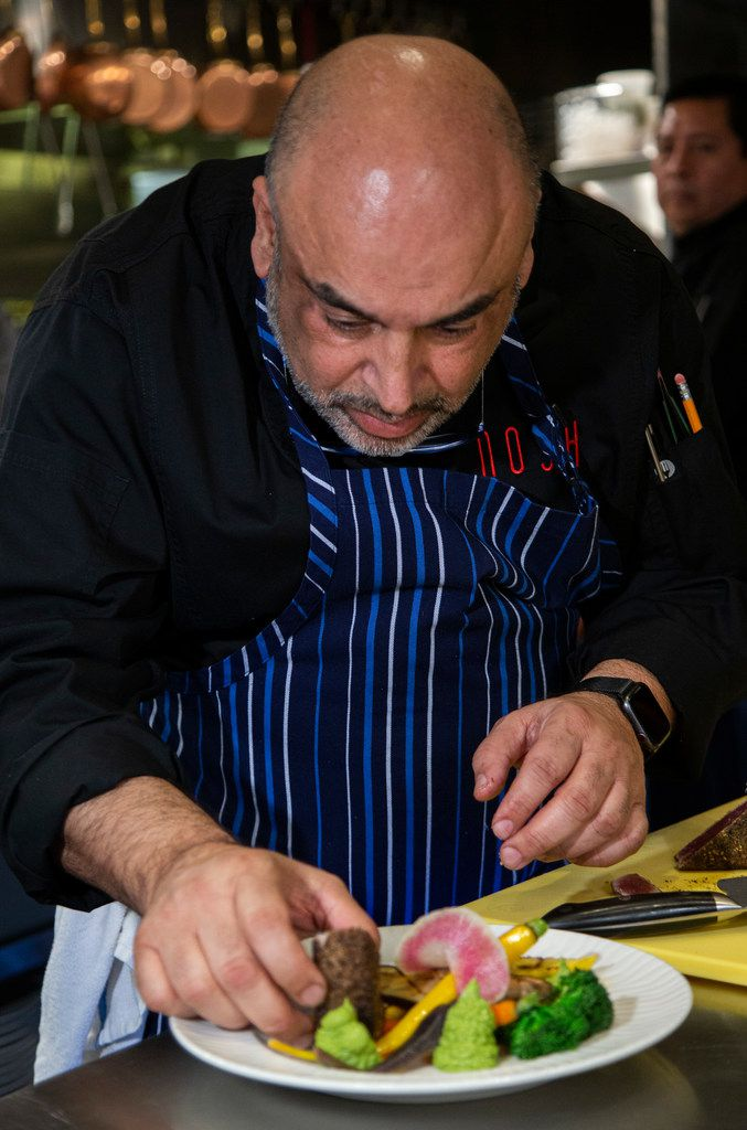 Chef Avner Samuel finishes a dish of za'atar crusted ahi.
