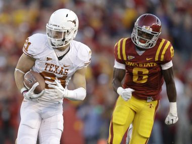 Texas safety Blake Gideon runs from Iowa State wide receiver Darius Darks, right, after intercepting a pass during the first half of an NCAA college football game Saturday, Oct. 1, 2011, in Ames, Iowa.