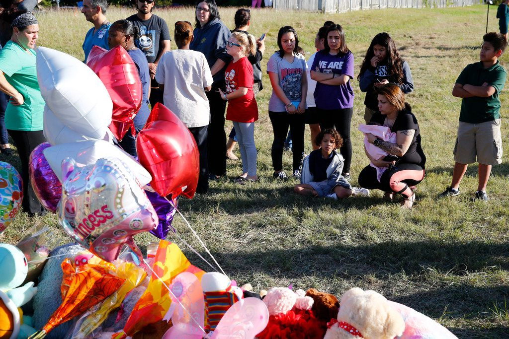 People gather near where Sherin Mathews was found Sunday morning in Richardson.