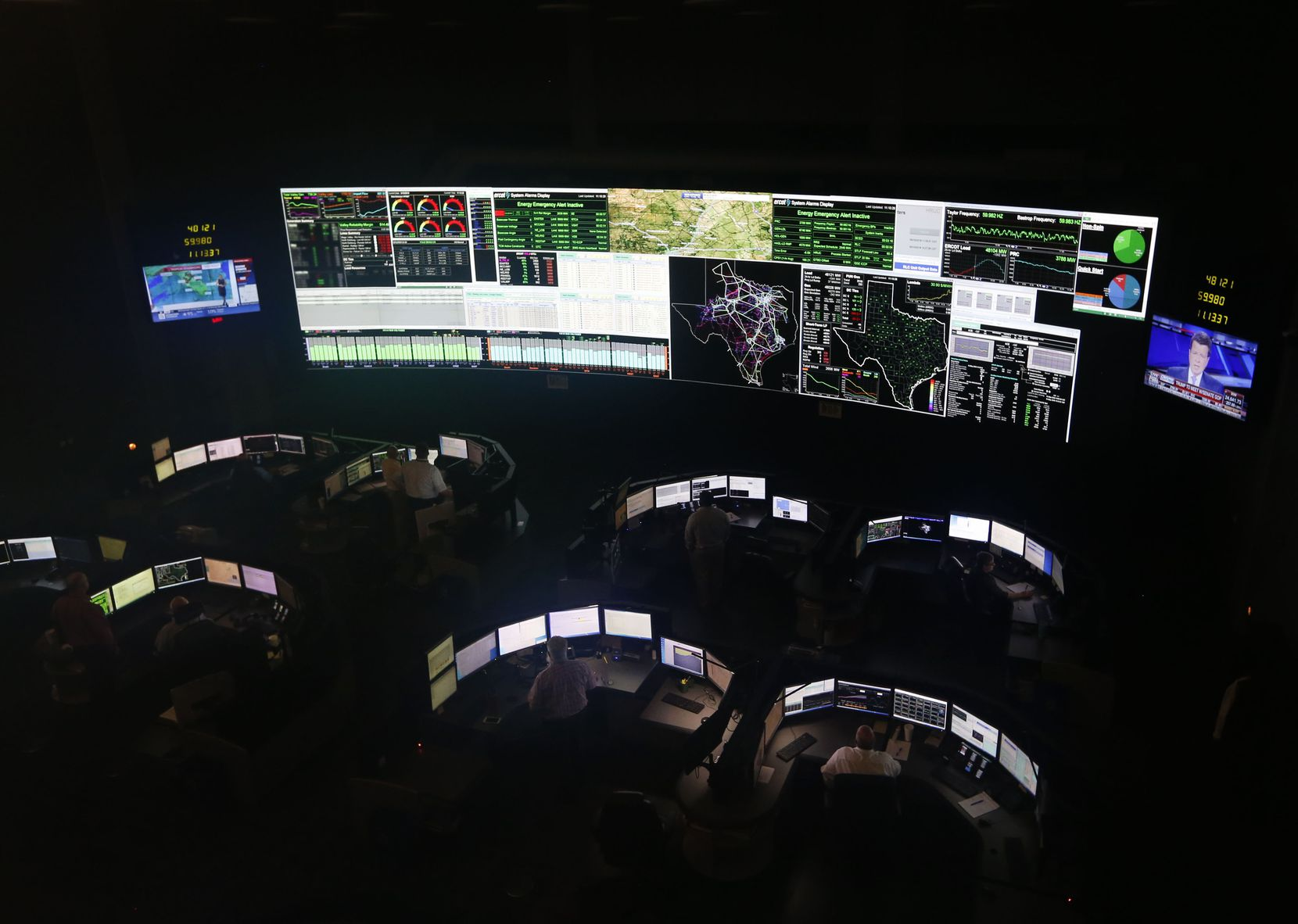 System operators worked in the command center of the Electric Reliability Council of Texas in Taylor on May 15, 2018. About 90 percent of Texas' electric load is managed by ERCOT.