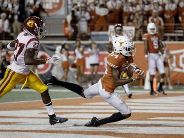 FILE - Texas receiver Joshua Moore hauls in a touchdown pass against USC last season. (Photo by Tim Warner/Getty Images)