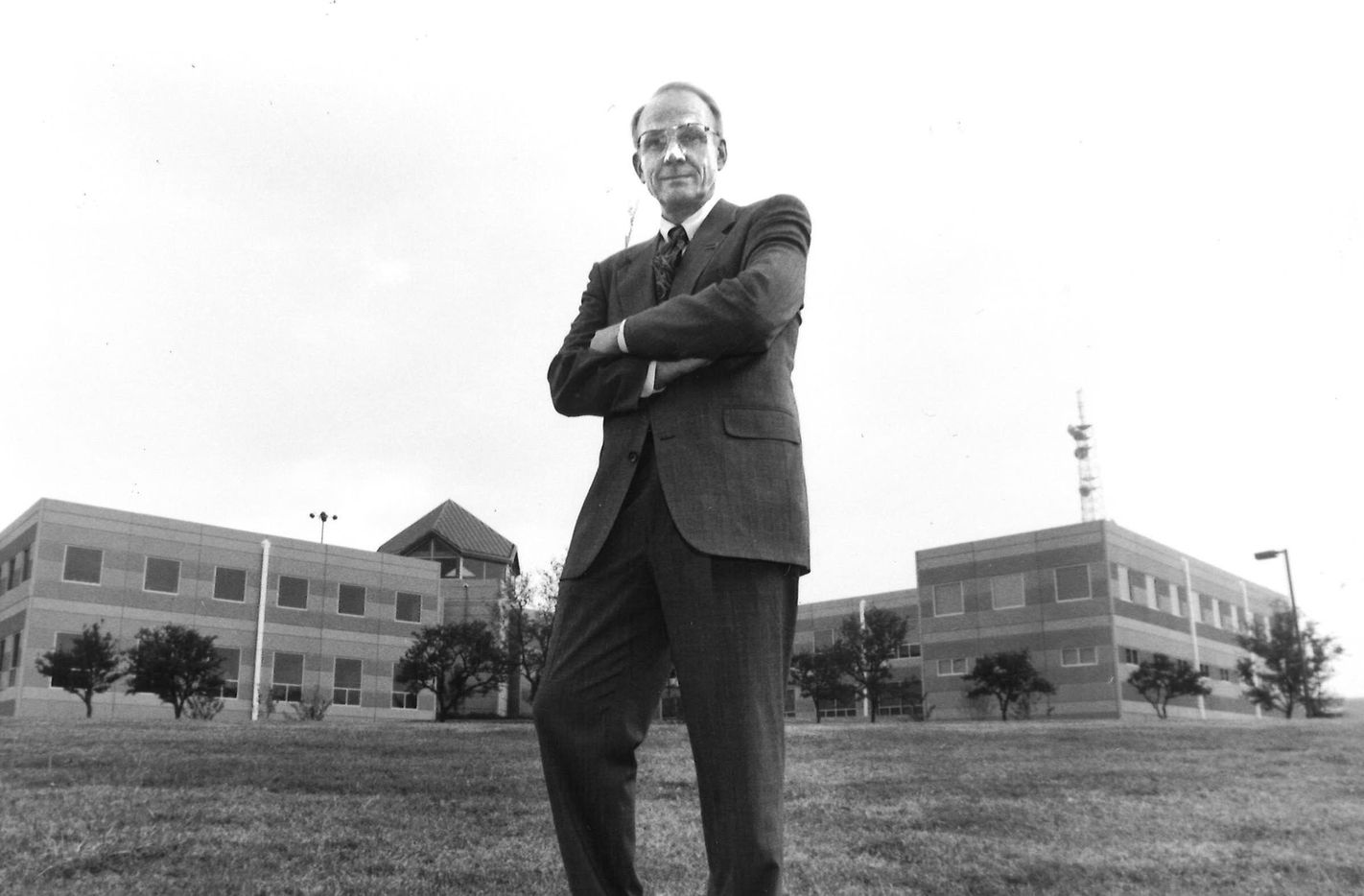 Dr. Robert H. Rutford, a former longtime president of the University of Texas at Dallas, outside of a new administration building that opened in October 1989.