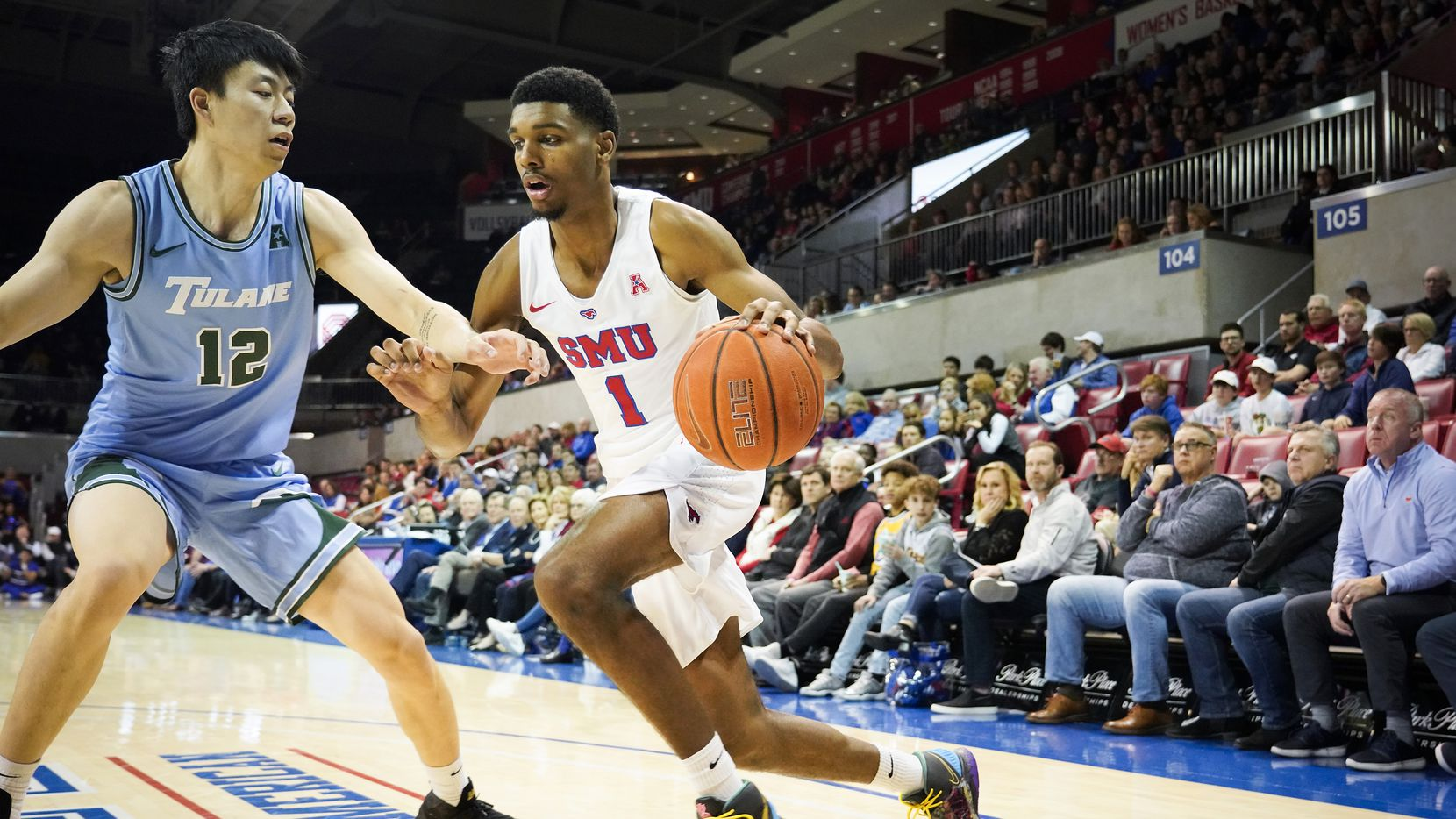 SMU forward Feron Hunt (1) dribbles around Tulane forward Kevin Zhang (12) during the second half of an NCAA basketball game at Moody Coliseum on Saturday, Feb. 1, 2020, in Dallas. SMU won the game 82-67.