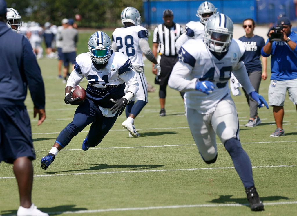 Dallas Cowboys running back Ezekiel Elliott (21, left) runs up the field as Dallas Cowboys running back Jamize Olawale (49) leads the way during practice at The Star in Frisco, Texas on Wednesday, September 4, 2019.