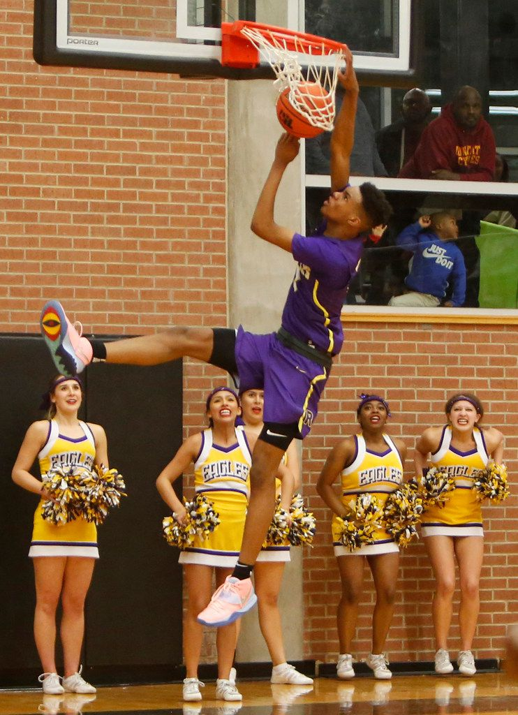Richardson guard Rylan Griffen (3) finishes off an uncontested dunk to the anticipated excitement of Eagles cheerleaders during the final minute of their game against DeSoto. Richardson defeated DeSoto 63-51 to advance. The two teams played their Class 6A boys bi-district playoff basketball game at Forney High School in Forney on February 24 2020. (Steve Hamm/Special Contributor).