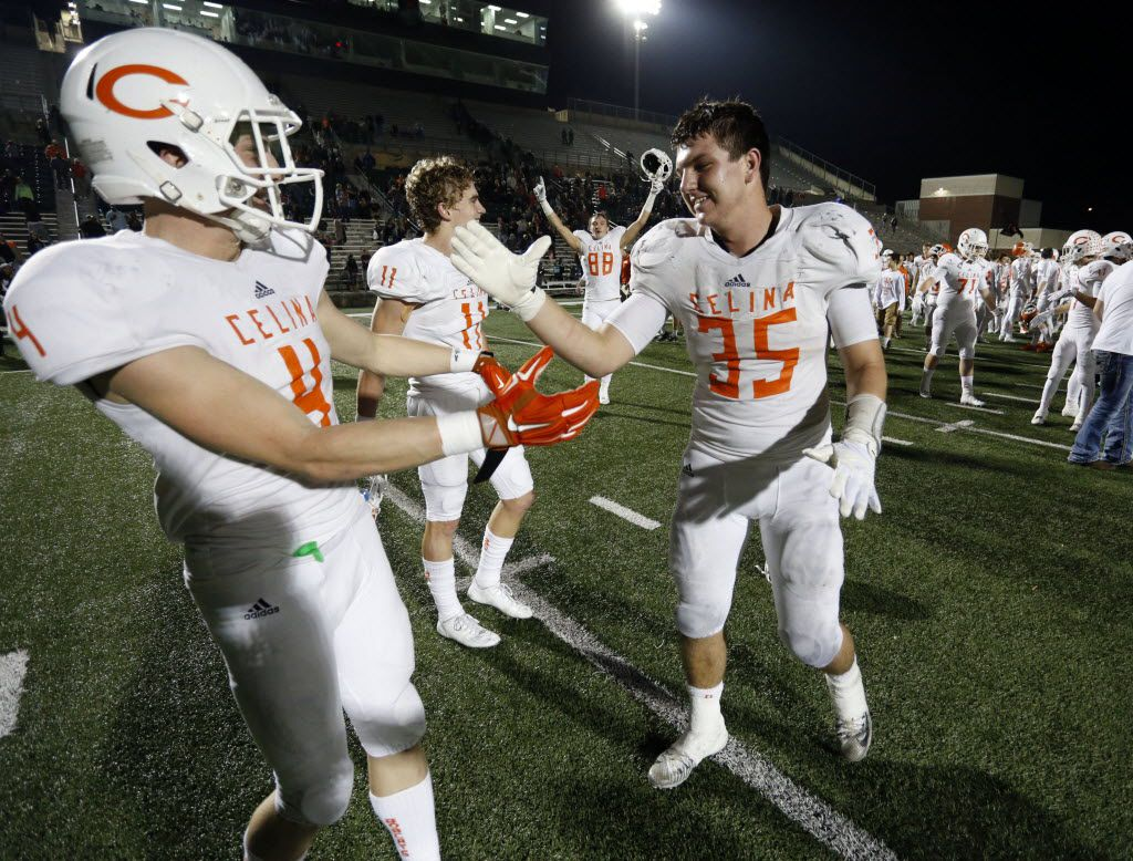 (TXHSFB) Celina High's Shane Gerths (35) celebrates with teammates, including Luke Reeder (4); Trace Young (11) and Riley Nebeker (88), after the team's 44-49 win over Gilmer in a high school football playoff game on Friday, December 11, 2014. (John F. Rhodes / Special Contributor)