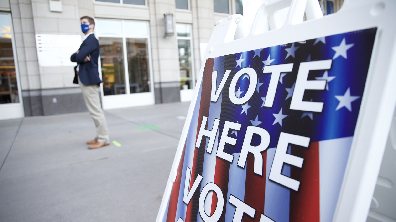 A voter waits in line at the American Airlines Center in Dallas before polls open the morning of Election Day, Tuesday, Nov. 3, 2020. (Juan Figueroa/The Dallas Morning News)