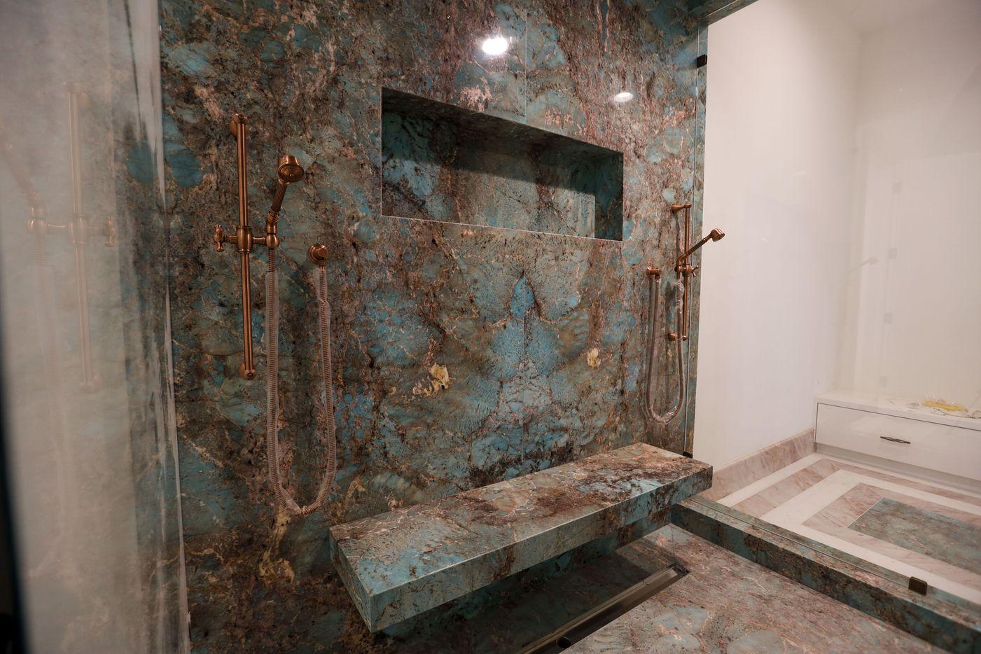 The master bathroom has an Amazonite walk-through shower.