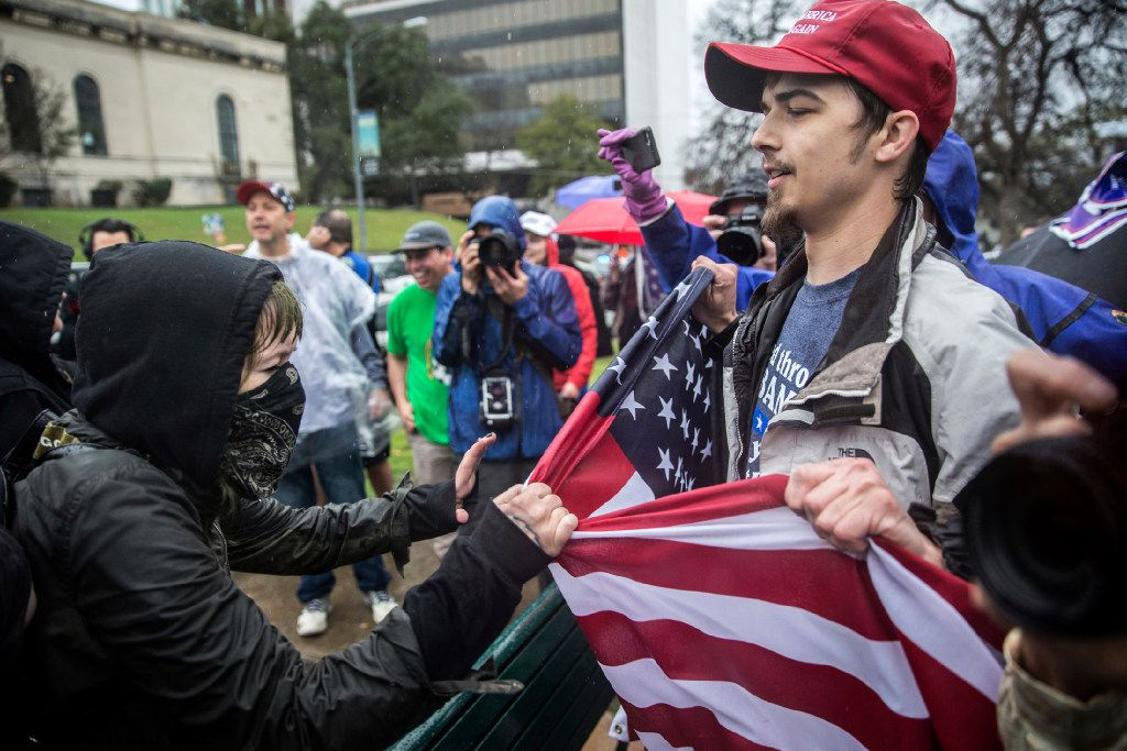 """Counter-protesters clash with supporters of President Donald Trump at Wooldridge Park in Austin, Texas, during a """"March 4 Trump,"""" rally, one of several such events held in cities around the U.S. on Saturday, March 4, 2017. (Tamir Kalifa /Austin American-Statesman via AP)"""
