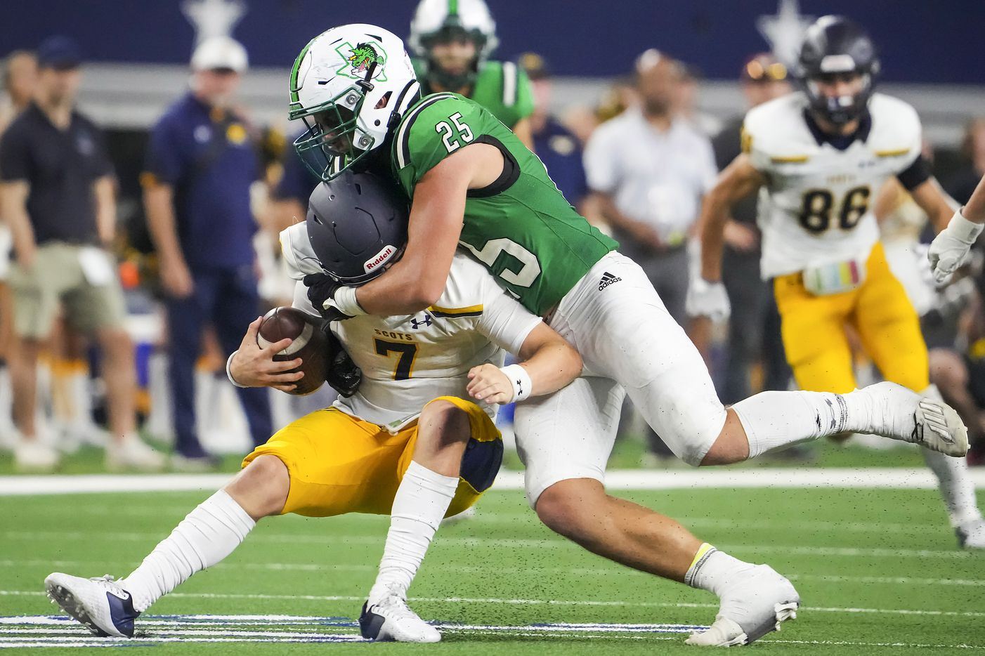 Highland Park quarterback Brennan Storer (7) is sacked by Southlake Carroll defensive lineman Barrett Baker (25) during the second half of a high school football game at AT&T Stadium on Thursday, Aug. 26, 2021, in Arlington.