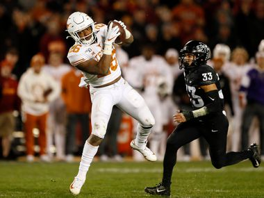 Texas running back Keaontay Ingram catches a 22-yard touchdown pass in front of Iowa State defensive back Braxton Lewis (33) during the second half of an NCAA college football game, Saturday, Nov. 16, 2019, in Ames, Iowa. Iowa State won 23-21. (AP Photo/Charlie Neibergall)