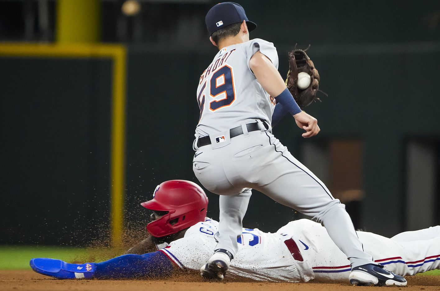 Texas Rangers center fielder Adolis Garcia is out at second base on a stolen base attempt as Detroit Tigers shortstop Zack Short prepares to make the tag during the fourth inning at Globe Life Field on Tuesday, July 6, 2021.