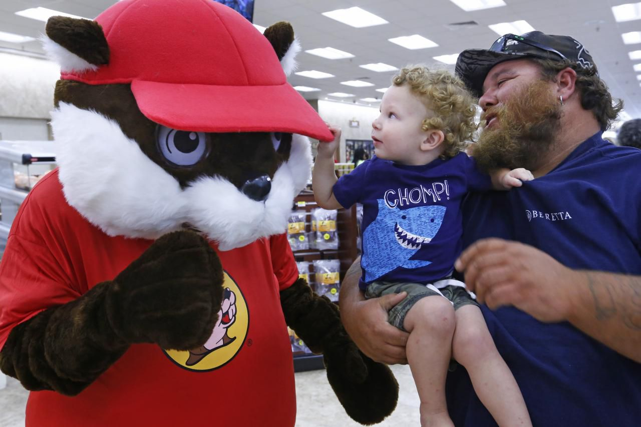 Doug Rommell and his 23-month-old son, Hunter, of Mesquite checked out the Buc-ee's mascot Monday during the opening of the Terrell store at Interstate 20 and FM148.