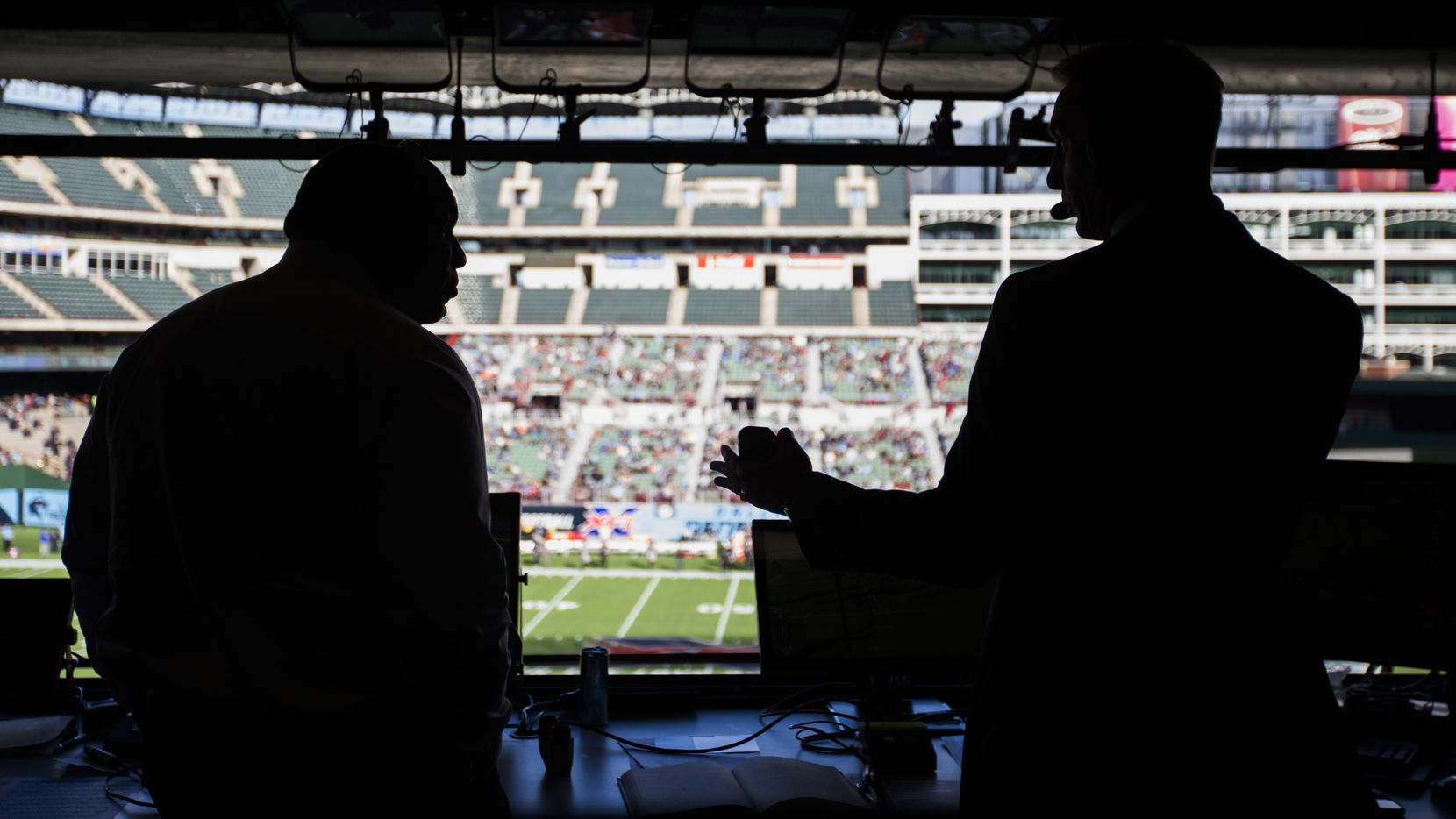 FOX Sports broadcasters Curt Menefee (left) and Joel Klatt call an XFL game between the Dallas Renegades and the New York Guardians on Saturday, March 7, 2020 at Globe Life Park in Arlington. (Ashley Landis/The Dallas Morning News)