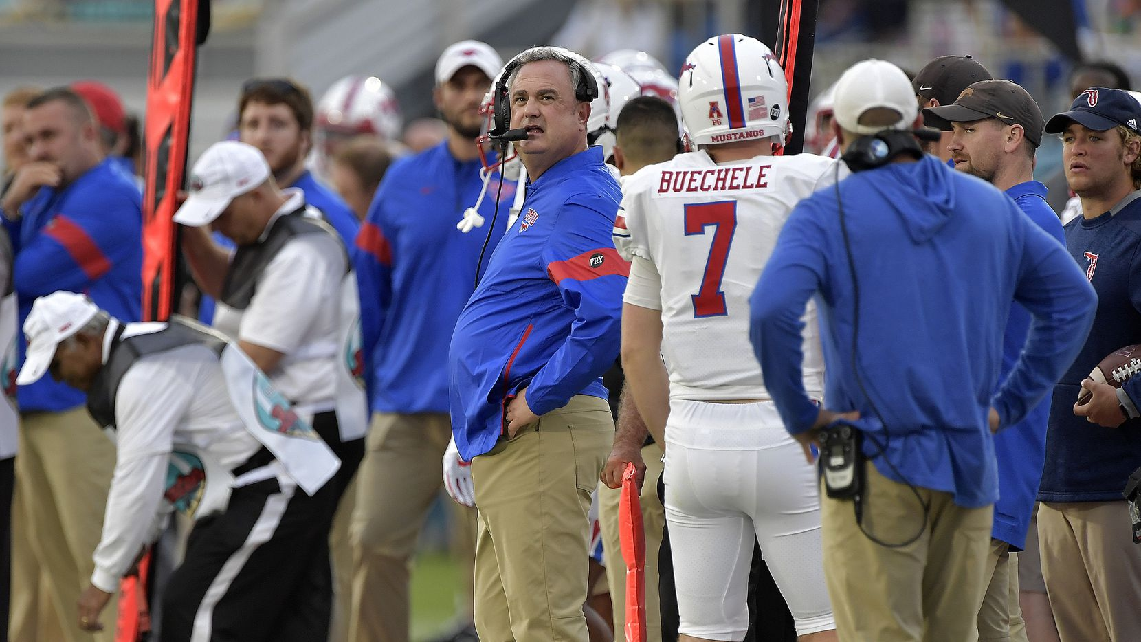 SMU coach Sonny Dykes, center, looks up at the scoreboard during the first half of the Boca Raton Bowl NCAA college football game against Florida Atlantic, Saturday, Dec. 21, 2019, in Boca Raton, Fla. (Michael Laughlin/South Florida Sun-Sentinel via AP)