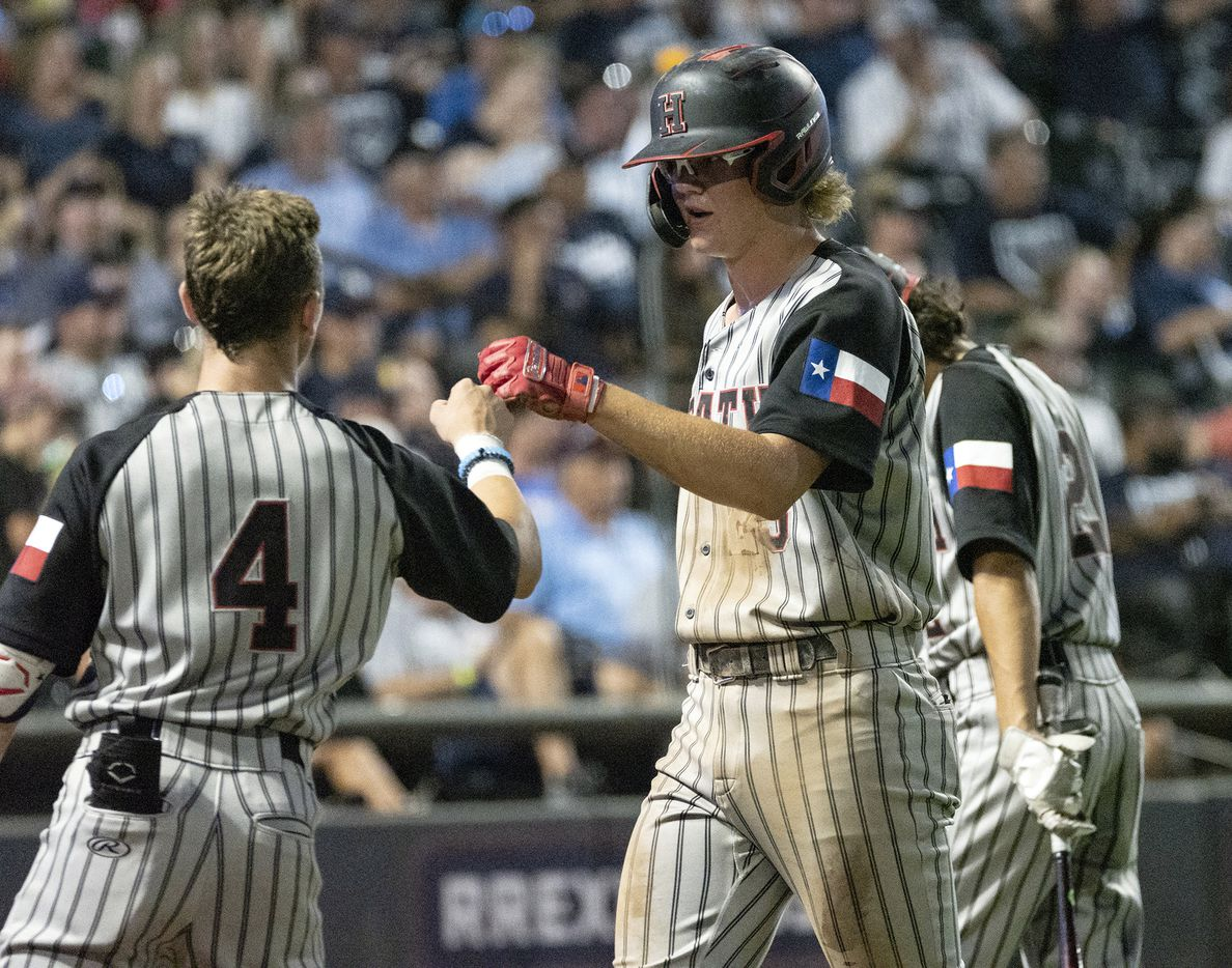 Rockwell-Heath Kaston Mason, (25), and Jett Williams, (4), celebrate a run against Comal Smithson Valley during the third inning of the 2021 UIL 6A state baseball semifinals held, Friday, June 11, 2021, in Round Rock, Texas.    (Rodolfo Gonzalez/Special Contributor)
