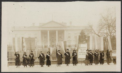 Suffragists are pictured picketing in front of the White House in 1917.