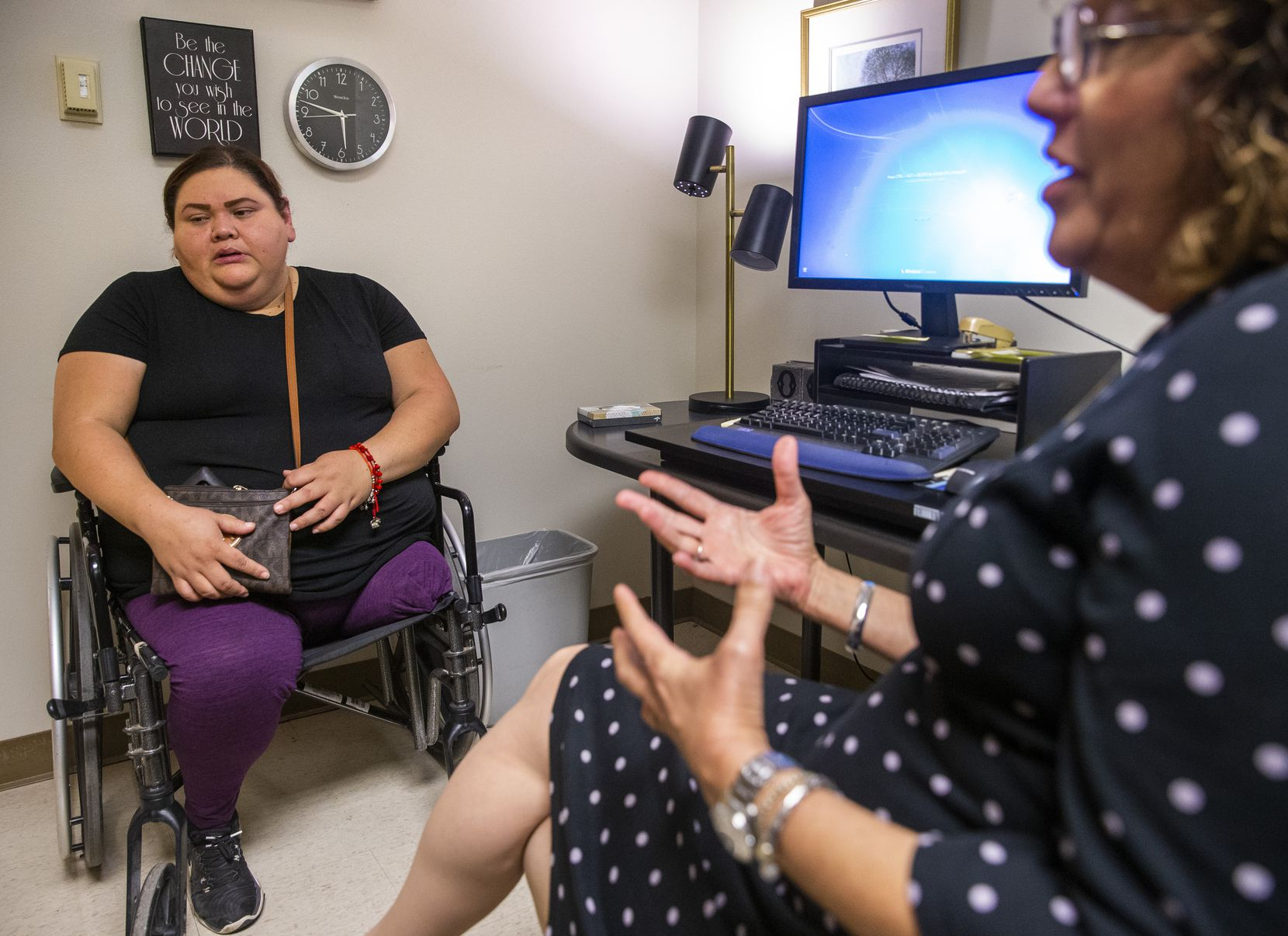 Guadalupe Vergara, 40, from Oak Cliff listens to Ana Castellanos talk about her experience counseling Vergara at the mental health hub of the deHaro-Saldivar Health Center in Dallas. Vergara sought counseling after she received a double amputation on her left leg last year.