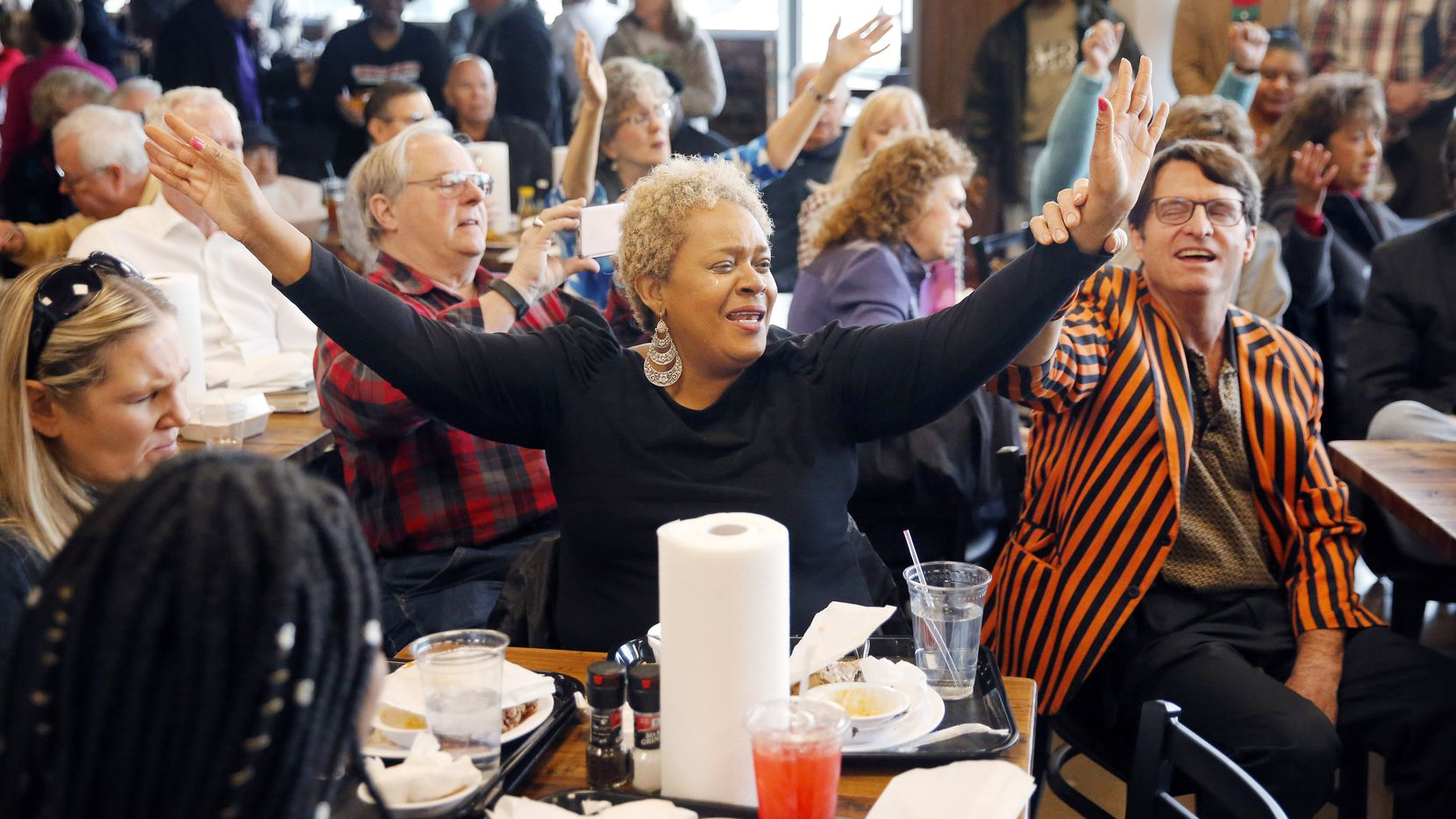 Gladys Lewis of Little Elm (center) and Brad Urschel (right) worship during the weekly Bible Study at Smokey John's Bar-B-Que and Home Cooking on Mockingbird Lane in Dallas, on Tuesday, Jan. 29, 2019. John 'Smokey' Reaves has been doing Tuesday Bible study at his barbecue joint since 1982.  A fire in 2017 destroyed the restaurant, which re-opened this week after much restoration.