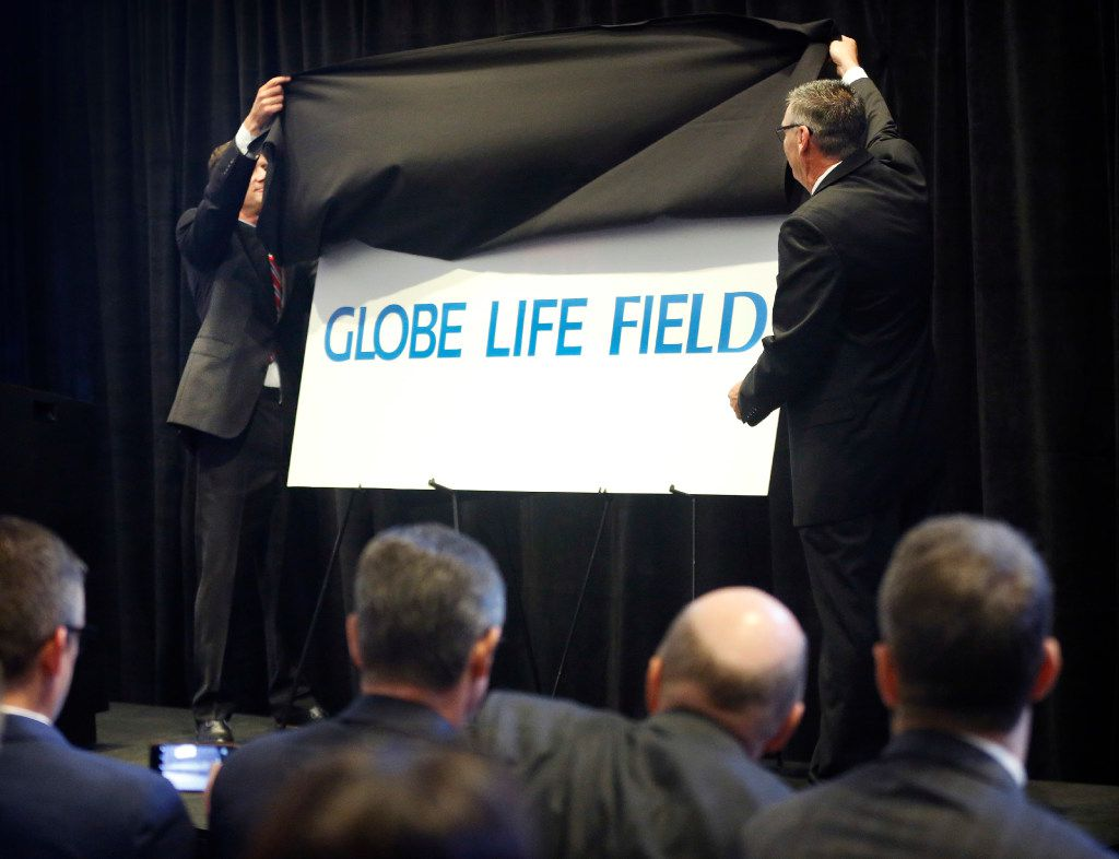 Texas Rangers Executive Vice President and Chief Revenue and Marketing Officer Joe Januszewski (left) and Globe Life Director Response President and CEO Bill Leavell (right) unveil the new name of the air-conditioned ballpark during a press conference at Globe Life Park in Arlington on Aug. 24. Globe Life And Accident Insurance Company will extend the naming rights for the $1.1 billion stadium through the year 2048. The new name will be Globe Life Field.
