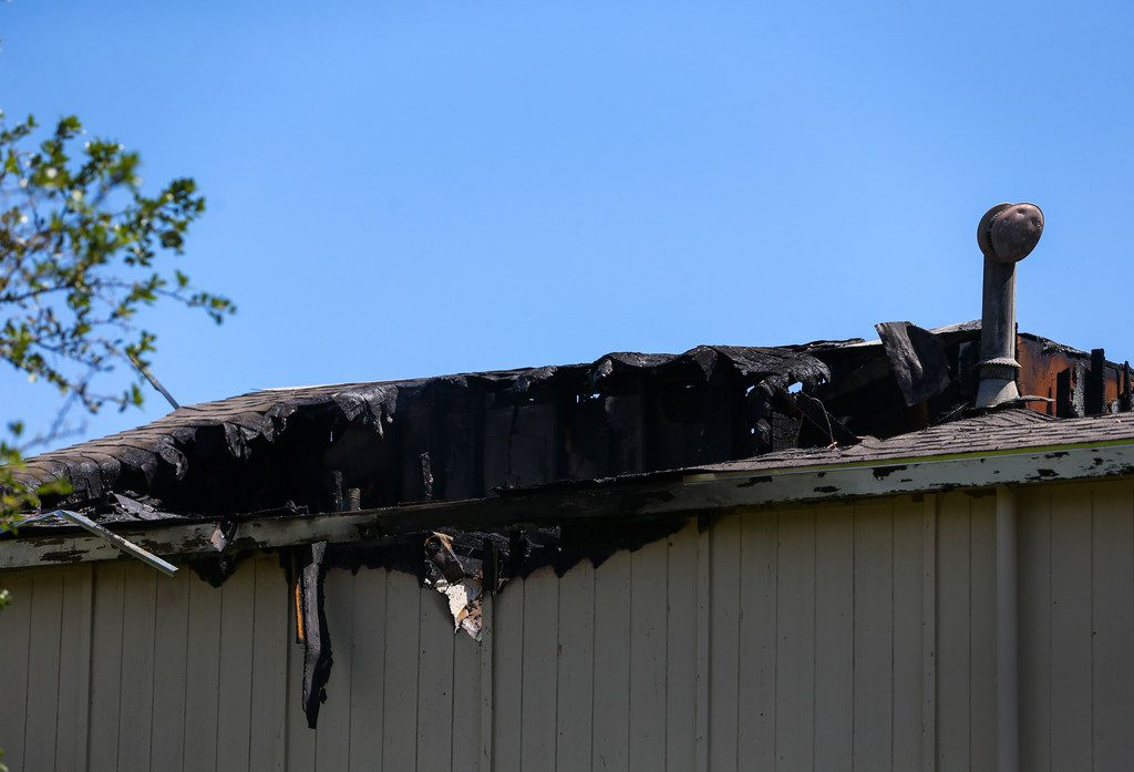 A collapsed roof is seen at the scene of a 3-alarm apartment fire at 1226 N. Masters Drive on Friday, April 26, 2019 in Dallas. (Ryan Michalesko/The Dallas Morning News)