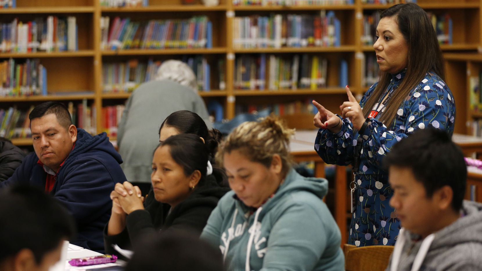 Principal Sandra Barrios talks to parents at Jack Lowe Sr. Elementary School in Dallas.